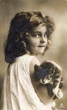 Young girl with kitten (real photo postcard)  Another photo of the same model and cat.