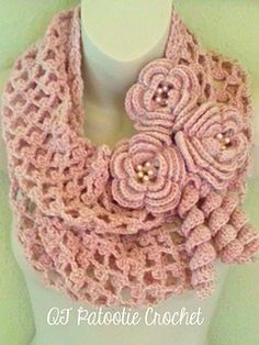 A lovely infinity scarf crocheted in a light and airy pattern with beautiful large irish crochet flowers and curliques.