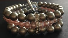Platinum and Pink Pearl Triple Strand by DesignsbyLolaBelle