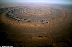 The Richat Structure, also known as the Eye of the Sahara and Guelb er Richat, is a prominent circular feature in the Sahara desert of west–central Mauritania near Ouadane. This structure is a deeply eroded, slightly elliptical, 40 km in diameter dome.