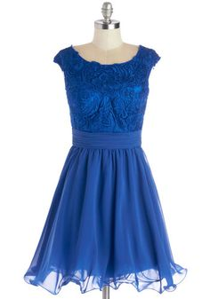 This bright blue, cap-sleeved frock exudes effortless grace from every inch of its A-line silhouette - including the intricately embroidered bodice and the fluttery lettuce hem - creating a picture-perfect look.