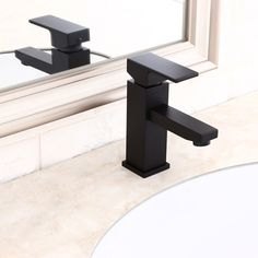 Dree Brass Single Hole Single Handle Brass Bathroom Sink Faucet in Solid Black, sold at US$82.99 .