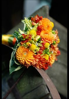This is the perfect bouquet for my fall wedding. A nice splash of color to go with the black and ivory dresses. (Though I would go with a black wrap ribbon for matching purposes!)