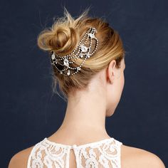 A perfectly imperfect messy bun gets an elegant update with this Swarovski crystal-encrusted hair garland. Learn how to create a  simple bun  to accessorize with this stunning clip.    Click for hairstyle tutorial.