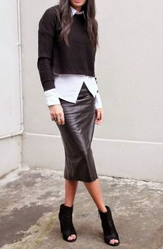 black leather skirt, white button-down (not tucked in), black sweater, black boots/heels