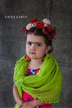 @Laia Martín Polo, qué te parece?  Little Frieda - cute costume if anyone around here actually had any idea who Frida Kahlo is.