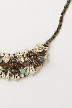 Anthropolgie necklace.... gives me an idea for using junk jewelry with old lace. hmmmm.