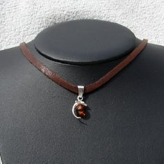 amber dolphin necklace by Moonlight Mining