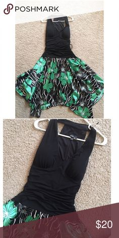 Tropical Dress NWOT. Black gathered halter dress with asymmetrical silk like skirt. GORGEOUS! I bought this to wear to a luau and didn't! I love this dress. The skirt would be perfect to  in✨Top Rated Seller ✨  Fast Shipping Times  Quick Responses  ✅ Great Items ✅  Awesome Bundle Deals  Thanks For Visiting!  ! Dresses Asymmetrical