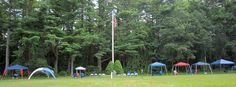 """Campsite"" Tim O'Neil before a Sunday Dress Parade at Camp Yawgoog; on the Orange Trail.  A 2013 image by David R. Brierley.  Facebook cover photo."