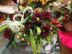 Nestled in a gorgeous wooden basket, this arrangement was made by Julie, in our flower shop!