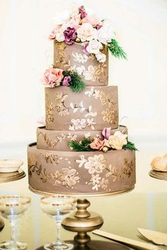 Painted wedding cake on gold pedestal.  Those glasses look similar to our new champagne glasses!