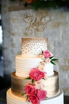 Classic, gold wedding cake idea with pink flower and gold cake topper {Hyde Park Photography}
