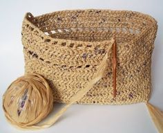 Super cool DIY project -crocheted basket made from plarn - yarn made from plastic bags.  Can't wait to try it!