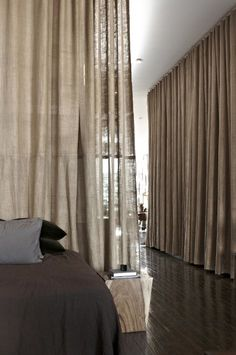 burlap curtains as room dividers (why hasn't anyone considered making burlap partitions from old doors, hinges and burlap? except me