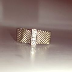 Tiffany & Co ring Authentic Tiffany & Co somerset diamond mesh wide band ring Sterling silver round brilliant diamonds, diamond weight .06 vs1 Sterling silver like new Tiffany & Co. Jewelry Rings