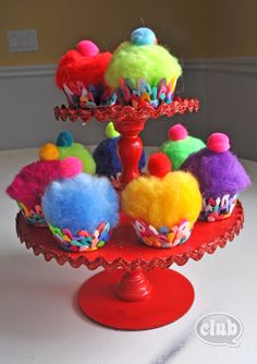 Melted bead cupcakes with pom poms and homemade mini cupcake tower