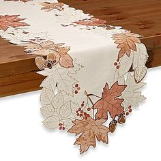 The Sam Hedaya Burwell Leaf Cutwork Table Runner is a classic and festive way to decorate your table for the autumn season. The beautiful design and soft material will impress your guests at every casual or formal event. Patchwork Table Runner, Table Runner And Placemats, Lace Table Runners, Table Runner Pattern, Cushion Embroidery, Purple Table, Leaf Stencil, Dining Room Table Decor, Fall Table