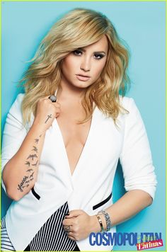 Demi Lovato keeps it sexy serious for the Summer 2014 cover of Cosmopolitan for Latinas.