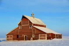 Red barn, white snow, blue sky | A nice big old barn on an unoccupied farmstead in rural Pierce County, ND.