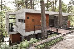 Corallo House by Paz Arquitectura in Guatemala City.    Love the folding concrete around the warmer wood.