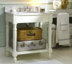 Replacing a traditional vanity cabinet with a console will help make a small bathroom appear larger. This Petaluma Single Sink from Pottery Barn features turned legs, a painted white finish, and Carrara marble top.