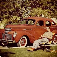 Walt Disney and his car relaxing.