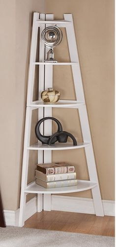 "White finish wood corner shelf unit , measures 29"" x 21"" x 63"" H. Some assembly required."