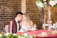 http://Bride%20and%20Groom%20sit%20at%20Burgundy%20Sweetheart%20Table%20at%20The%20Stockroom%20at%20230