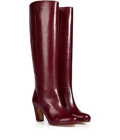 Cool contours and a blocky curved heel lend a contemporary look to these sleek leather boots from Maison Martin Margiela #Stylebop