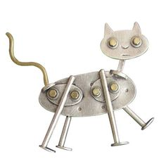 Catlik Brooch by Thomas Mann. The purr-fect pin for the cat lover! Created in sterling silver with brass additions. Due to the handmade nature of this pin, patterns may vary.