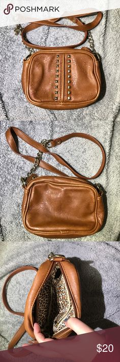 Cute cross body Like new cross body, very clean. Inside is cute leopard print with one zip pocket and one open. Bags Crossbody Bags