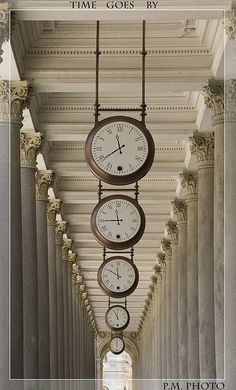 Time goes by | Flickr - Photo Sharing! If I had a long hallway, I would do this, setting each clock 15 minutes before the other, as if someone were looking into the future. Karlsbad, Czech Republic