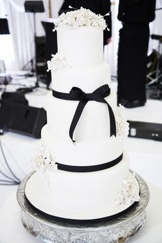 Wedding Cake with Black Ribbon  Photography: KingenSmith Read More: http://www.insideweddings.com/weddings/elegant-wedding-with-classic-black-white-color-palette-in-chicago/782/