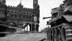 """ww2inpictures: """"A British Cromwell tank guards a bridge over the Elbe river. Hamburg, Germany. 3rd of May 1945. """""""