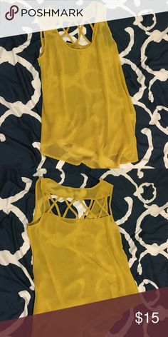 Mustard Tank Top - Asymmetrical bottom Flowy fit. Size says 4 but it can fit up to medium/large. The bottom is asymmetrical with a crisscross back Finders Keepers Tops Tank Tops