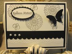 Card Stock:  Basic Black, Very Vanilla  Stamp Set:  Reason to Smile, Kindness Matters  Ink:  Craft Black  Punchs:  Large Oval, Scallop Oval, Elegant Butterfly, Scallop Edge  Big Shot:  Delicate Designs Embossing Folder  Accents:  Pearls