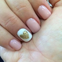 Pink daisy gel nail polish with gold glittered heart decorated nail. So pretty! | Yelp