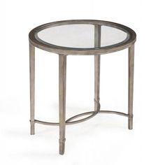 The Copia end table features a swooping metal tube frame finished in elegant antique silver. This lovely accent table is topped with a sleek 5 mm clear tempered glass surface.