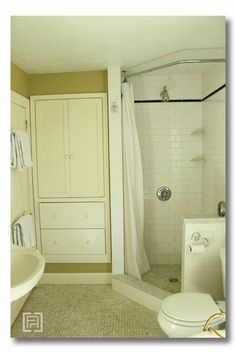 love how this shower stall has been extended just a little to accommodate a curtain which