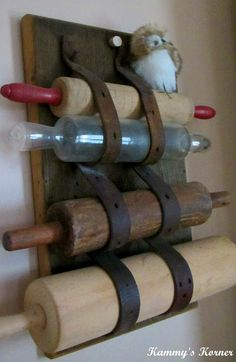Hang rolling pins with old belts - check out the clear rolling pin!!!