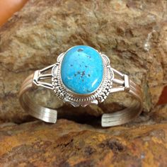 This beautiful Sterling Silver Bracelet features Kingman Turquoise found in Northwestern Arizona. Created by Navajo jewelers and Navajo silversmiths. Colors may vary due to different computer monitors