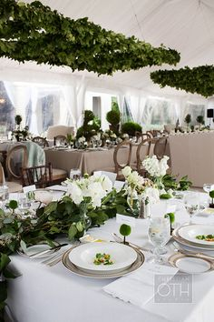 Lemon leaf garlands make for lush centerpieces | @christianoth | Brides.com
