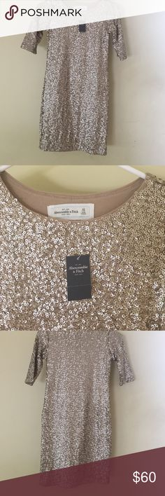 Gold Abercrombie and Fitch Sparkly Dress Very comfortable to wear not that itchy. Has short sleeves and fits to your body. Abercrombie & Fitch Dresses Midi