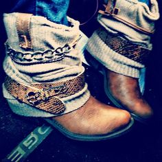 Diy boots I made. Transformed some bustery $3 Wal-Mart cowboy boots with a belt I cut, sweater sleeves, and some chain.