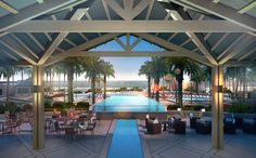 Available March 2013 (rendering) - Poolside deck & bar overlooking the adult infinity edge pool with views of the blue Atlantic ocean
