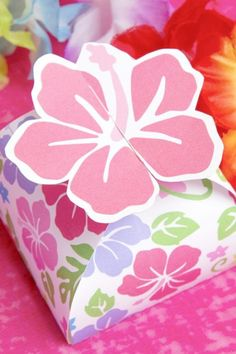 You can only imagine the look on your guest's faces when they set eyes on this pretty little box and open it up to find a surprise luau party favor! See more party ideas and share yours at CatchMyParty.com Luau Party Favors, Luau Party Supplies, Luau Party Decorations, Luau Birthday Cakes, Luau Photo Booths, Tropical Party Foods, Luau Cupcakes, Luau Food, Hawaiian Luau Party