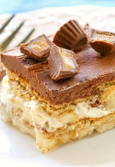 Chunky Monkey Eclair Cake is an easy no-bake dessert with layers of graham crackers, peanut butter filling, bananas and chocolate frosting.
