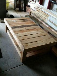 rustic coffee table made from pallets and scrap wood.