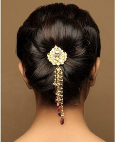 Dark haired updo with a jeweled pin hair accessory